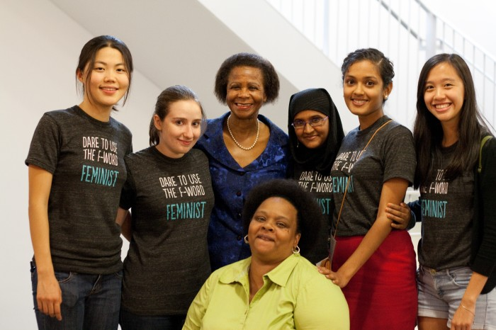 "6 Barnard Center for Research on Women staff (many wearing ""Dare to Say the F word - Feminist"" T-shirts) pose with Mamphela Ramphele"