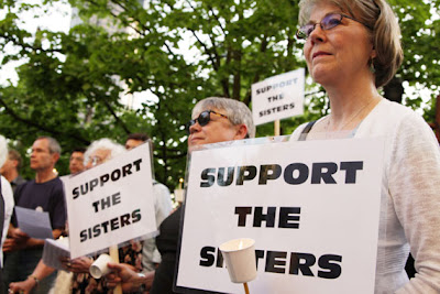 "Supporters of the Leadership Council of the Women Religious Gather with signs saying ""Support the Sisters"""