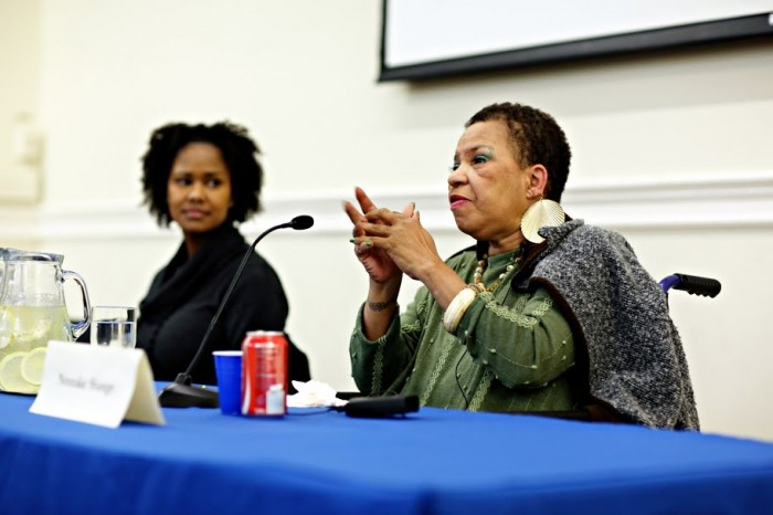 Ntozake Shange speaks into a microphone next to Soyica Diggs Colbert