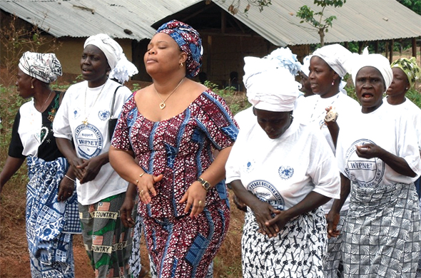 Leymah Gbowee leads a group of women